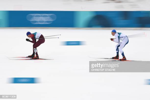 Russia's Alexander Bolshunov and Finland's Iivo Niskanen compete during the men's 50km cross country mass start classic at the Alpensia cross country...