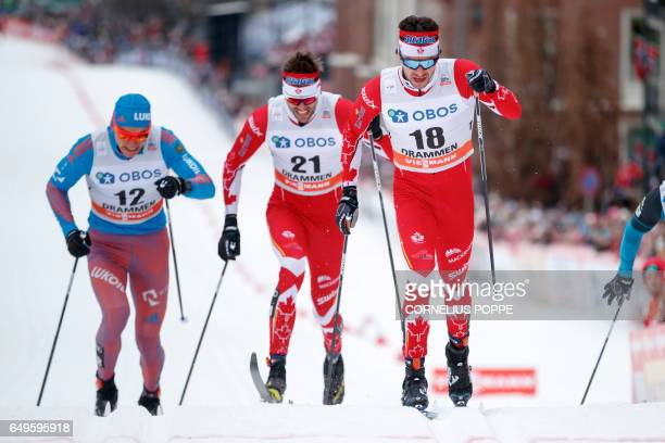 Russia's Alexander Bolshunov Canada's Len Valjas and Canada's Alex Harvey compete during the Sprint competition of the FIS Cross Country World Cup in...