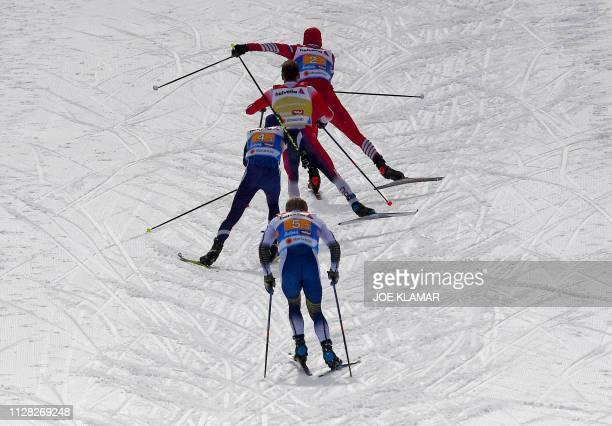 Russia's Alexander Bolshunov Norway's Sjur Roethe Finland's Matti Heikkinen and Sweden's Jens Burman compete during the Men's cross country skiing...