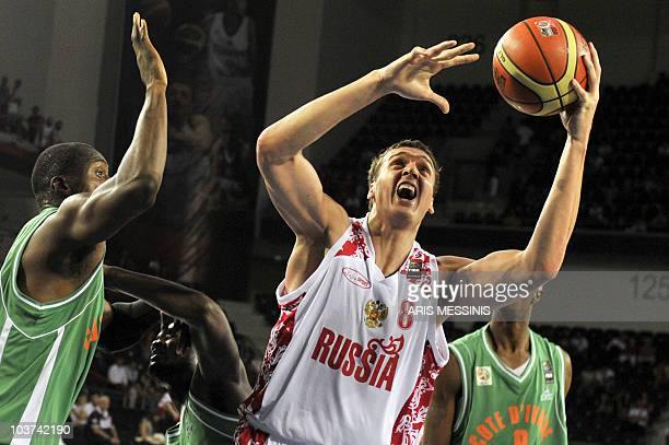 Russia's Alexander Kaun is marked by Mohamed Kone of Ivory Coast during their World Championship preliminary round basketball game in Ankara on...