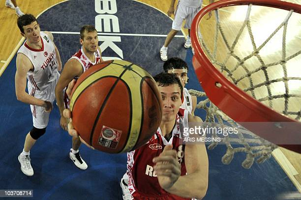 Russia's Alexander Kaun jumps to score against Turkey during their World Championship preliminary round basketball game in Ankara on August 29 2010...