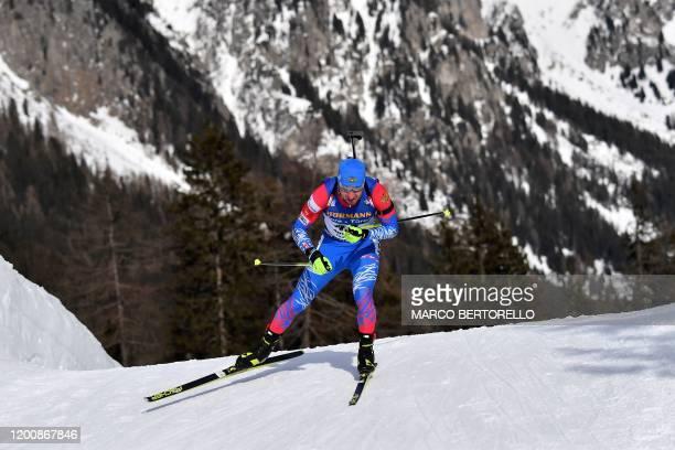 Russia's Alexander Loginov competes in the IBU Biathlon World Cup 10 km Men's sprint in Rasen-Antholz , Italian Alps, on February 15, 2020.