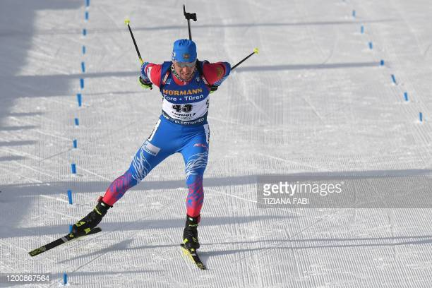 Russia's Alexander Loginov sprints to cross the finish line after competing in the IBU Biathlon World Cup 10 km Men's sprint in Rasen-Antholz ,...