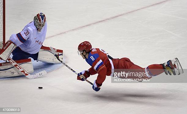 Russia's Alexander Ovechkin attacks on Norway's goalkeeper Lars Haugen during the Men's Ice Hockey playoffs qualification match Russia vs Norway at...