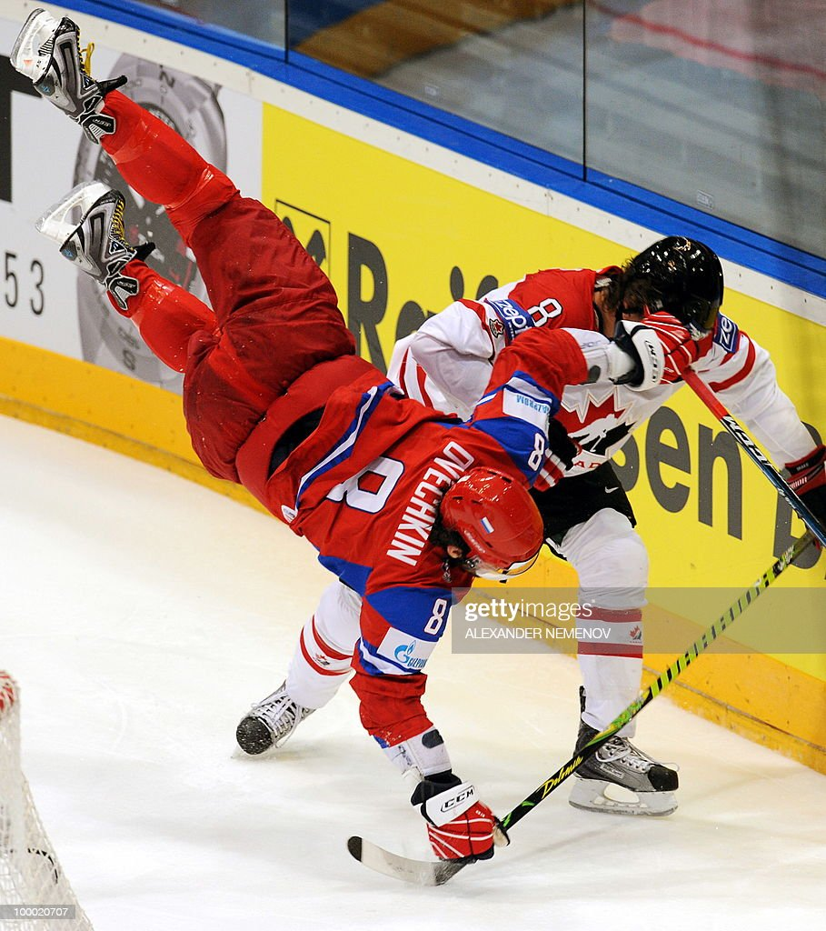 Russia's Alexander Ovechkin of NHL's Washington Capitals and Canada's Brent Burns of NHL's Minnesota Wild (R) vie during the IIHF Ice Hockey World Championship quarter-final match Russia vs Canada in the western German city of Cologne on May 20, 2010. The 2010 IIHF Ice Hockey World Championships are taking place in Germany from May 7 to 23, 2010.
