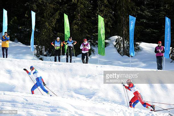 Russia's Alexander Panzhinskiy , compatriot Nikita Kriukov and Norway's Oeystein Pettersen compete in the men's Nordic Cross Country individual...