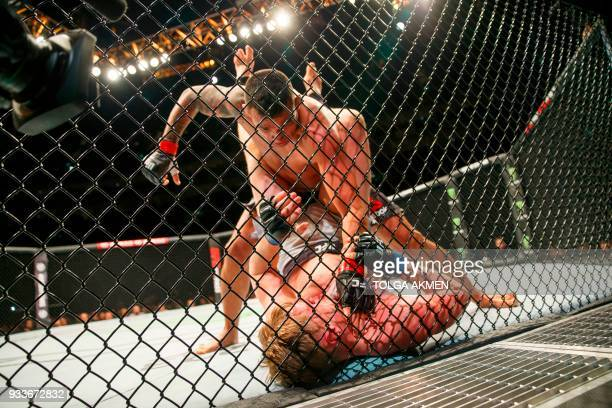 TOPSHOT Russia's Alexander Volkov fights Brazil's Fabrico Werdum in their Heavyweight fight during the UFC Fight Night at the O2 Arena in London on...