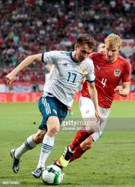 Russia's Alexandr Golovin and Austria's Martin Hinteregger vie for the ball during the international friendly football match Austria v Russia at the...