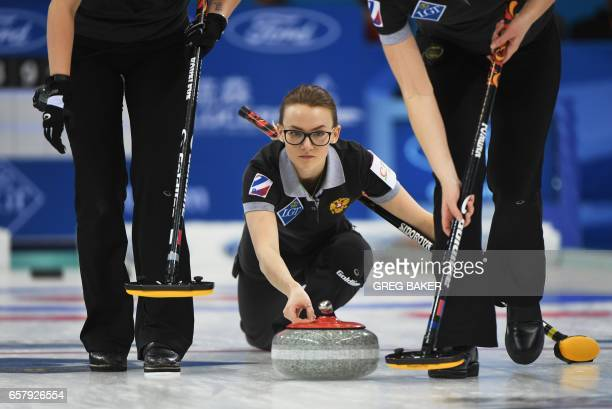 Russia's Alexandra Raeva releases the stone during the gold medal match against Canada at the Women's Curling World Championships in Beijing on March...