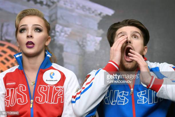 TOPSHOT Russia's Alexandra Stepanova and Ivan Bukin wait for the result after performing during their ice dance short dance at the ISU European...