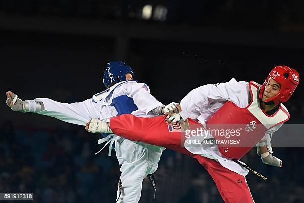 Russia's Alexey Denisenko competes against Jordan's Ahmad Abughaush during the men's taekwondo gold medal bout in the 68kg category as part of the...