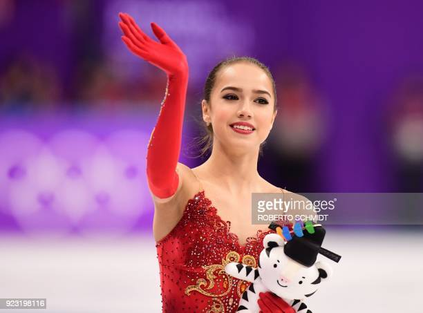 TOPSHOT Russia's Alina Zagitova celebrates her gold win after the venue ceremony in the women's single skating free skating of the figure skating...