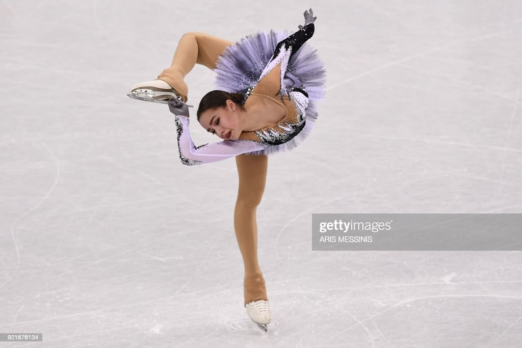 TOPSHOT - Russia's Alina Zagitova competes in the women's single skating short program of the figure skating event during the Pyeongchang 2018 Winter Olympic Games at the Gangneung Ice Arena in Gangneung on February 21, 2018. /