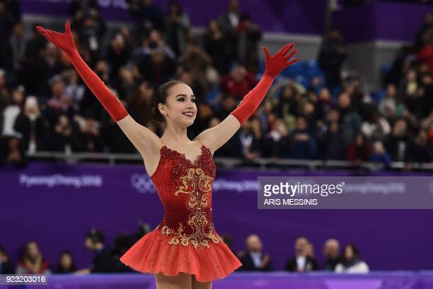 TOPSHOT Russia's Alina Zagitova reacts after before the venue ceremony after the women's single skating free skating of the figure skating event...