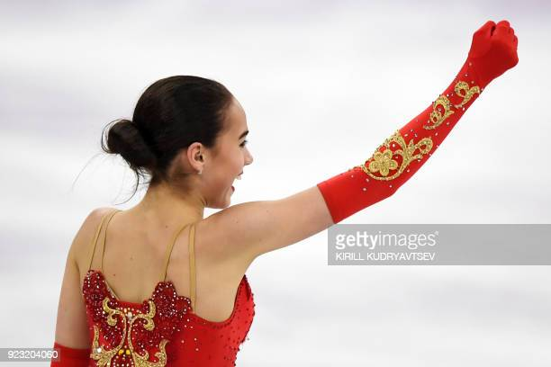 Russia's Alina Zagitova reacts after competing in the women's single skating free skating of the figure skating event during the Pyeongchang 2018...