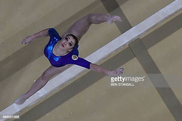Russia's Aliya Mustafina competes in the beam event of the women's individual allaround final of the Artistic Gymnastics at the Olympic Arena during...