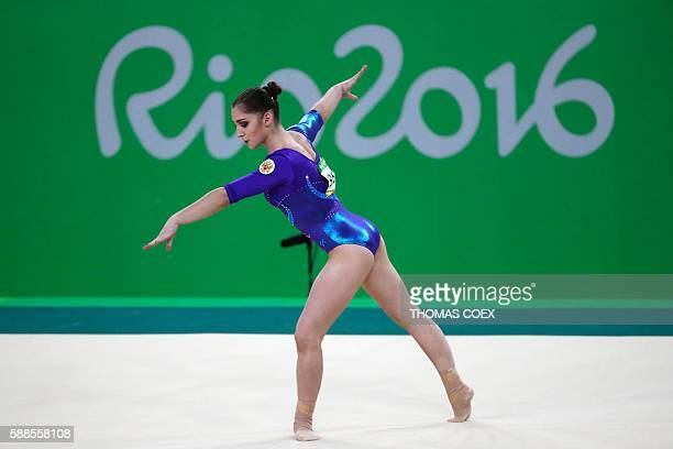 Russia's Aliya Mustafina competes in the floor event of the women's individual allaround final of the Artistic Gymnastics at the Olympic Arena during...