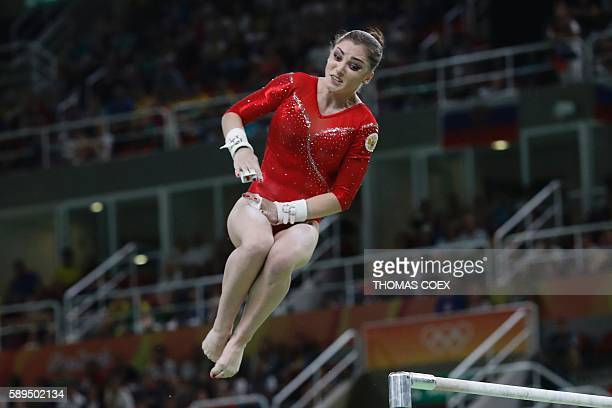 Russia's Aliya Mustafina competes in the women's uneven bars event final of the Artistic Gymnastics at the Olympic Arena during the Rio 2016 Olympic...