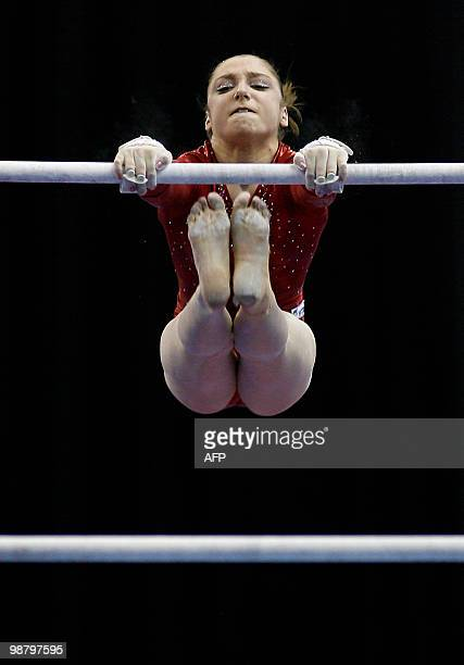 Russia's Aliya Mustafina performs on the uneven bars during the women seniors apparatus final in the European Artistic Gymnastics Championships 2010...