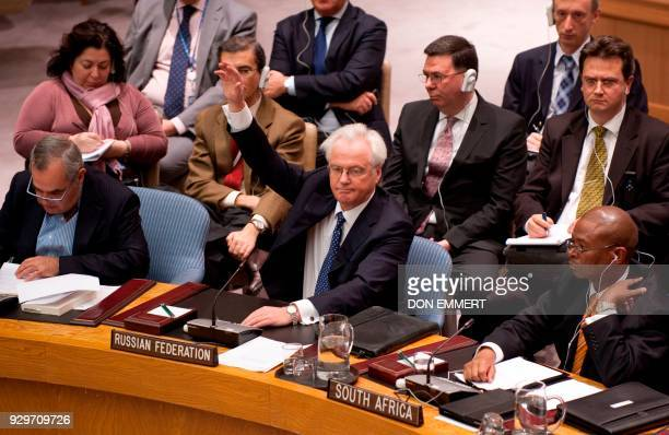 Russia's Ambassador to the United Nations Vitaly Churkin raises his hand to vote against a resolution on Syria in the United Nations Security Council...