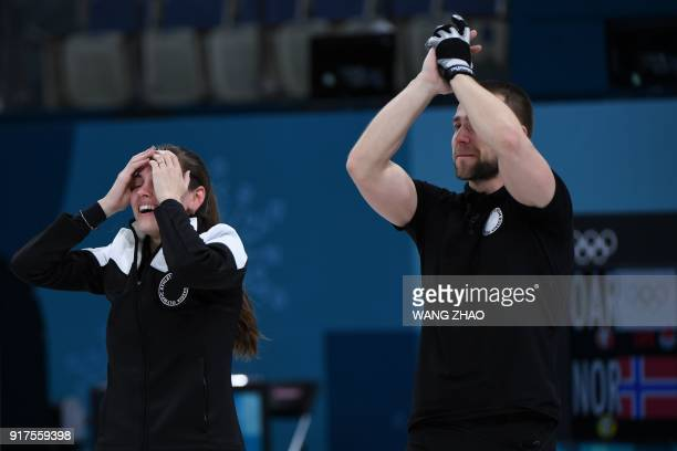 TOPSHOT Russia's Anastasia Bryzgalova and Russia's Aleksandr Krushelnitckii celebrate after winning the curling mixed doubles bronze medal game...