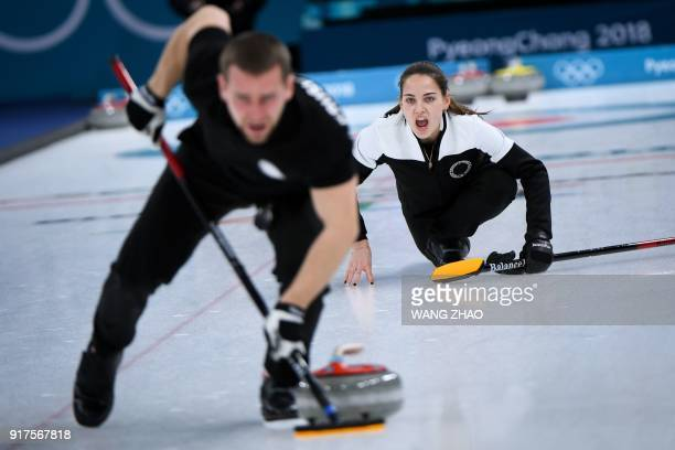 TOPSHOT Russia's Anastasia Bryzgalova shouts for instructions during the curling mixed doubles bronze medal game during the Pyeongchang 2018 Winter...