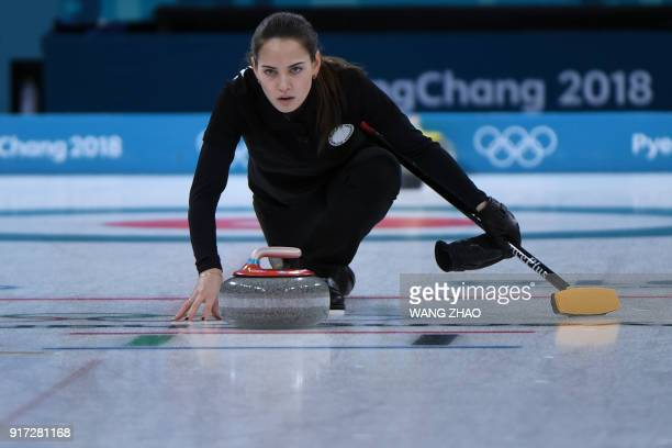 Russia's Anastasia Bryzgalova watches the stone during the curling mixed doubles semifinal during the Pyeongchang 2018 Winter Olympic Games at the...