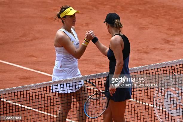 Russia's Anastasia Pavlyuchenkova and Belarus' Victoria Azarenka shake hands at the end their women's singles fourth round tennis match on Day 8 of...