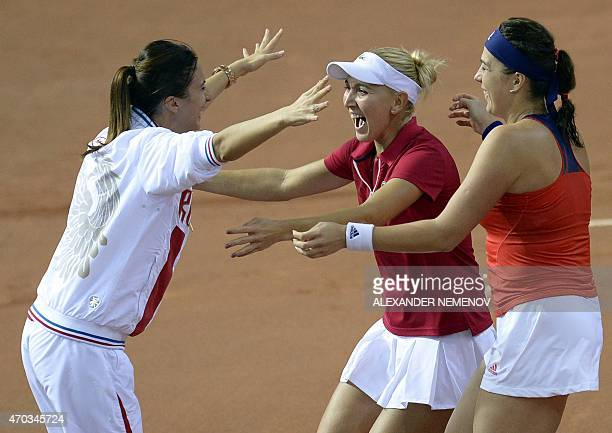 Russia's Anastasia Pavlyuchenkova and Elena Vesnina celebrate their victory over team Germany with their team captain Anastasia Myskina during their...