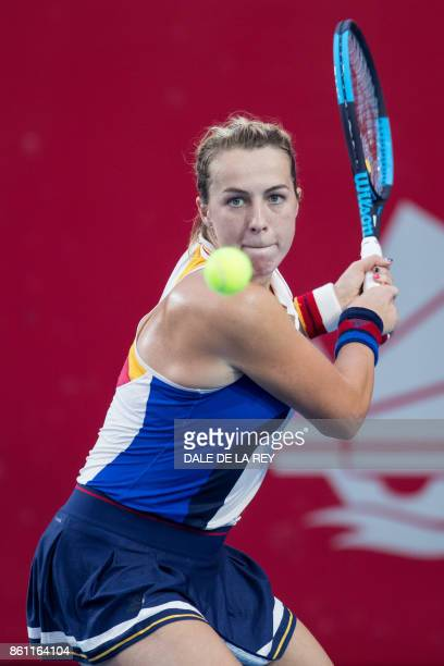 Russia's Anastasia Pavlyuchenkova hits a return against China's Wang Qiang during their women's singles semifinal match at the Hong Kong Open tennis...