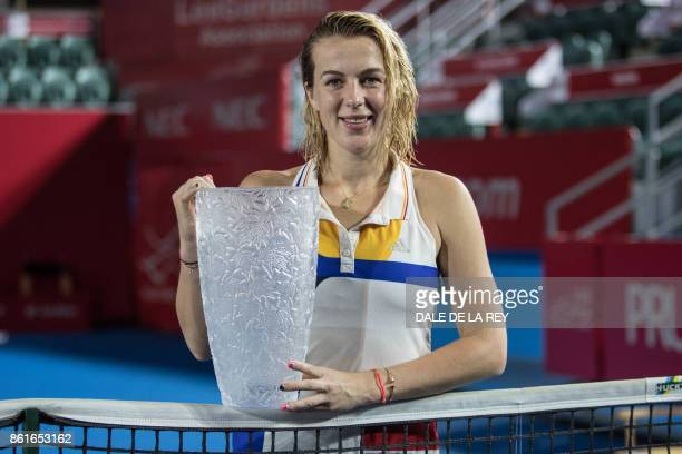 Russia's Anastasia Pavlyuchenkova poses with the winner's trophy after victory against Australia's Daria Gavrilova during the women's singles final...