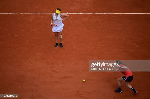 Russia's Anastasia Pavlyuchenkova receives a ball from a ball girl, during her women's singles third round tennis match against Belarus' Aryna...