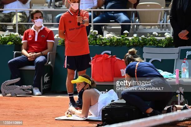 Russia's Anastasia Pavlyuchenkova receives medication as she plays against Czech Republic's Barbora Krejcikova during their women's singles final...