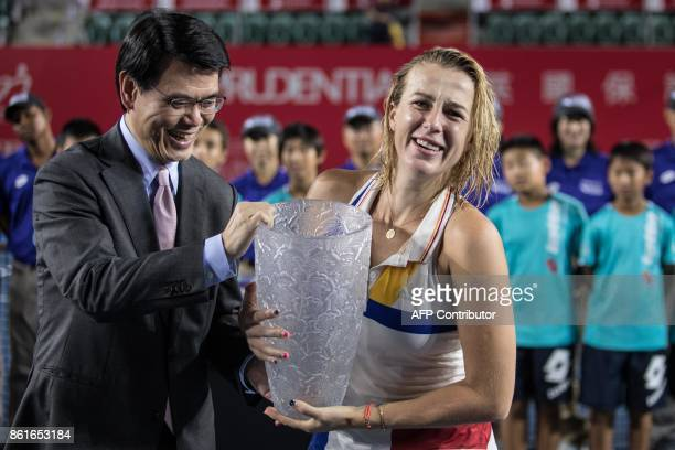 Russia's Anastasia Pavlyuchenkova receives the winner's trophy after victory against Australia's Daria Gavrilova during the women's singles final at...