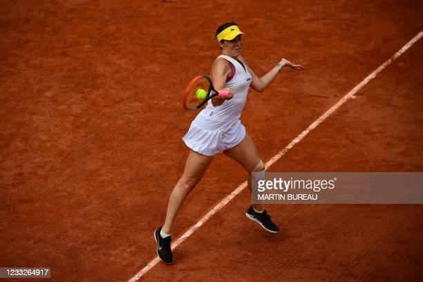 Russia's Anastasia Pavlyuchenkova returns the ball to Belarus' Aryna Sabalenka during their women's singles third round tennis match on Day 6 of The...
