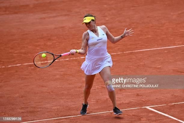 Russia's Anastasia Pavlyuchenkova returns the ball to Belarus' Victoria Azarenka during their women's singles fourth round tennis match on Day 8 of...
