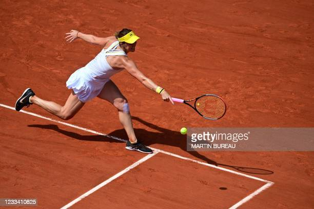 Russia's Anastasia Pavlyuchenkova returns the ball to Czech Republic's Barbora Krejcikova during their women's singles final tennis match on Day 14...