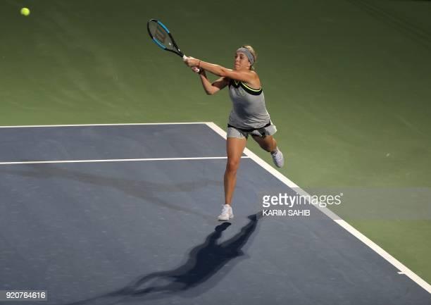 Russia's Anastasia Pavlyuchenkova returns the ball to Johanna Konta of Great Britain during day one of the WTA Dubai Duty Free Tennis Championship at...