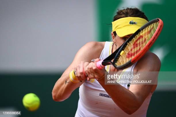 Russia's Anastasia Pavlyuchenkova returns the ball to Kazakhstan's Elena Rybakina during their women's singles quarter-final tennis match on Day 10...