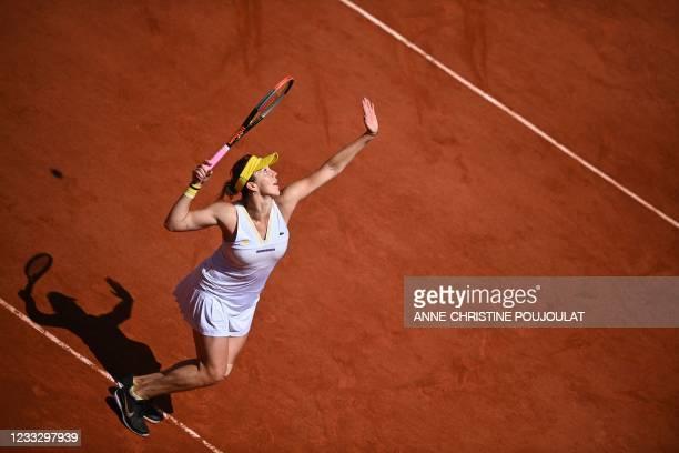 Russia's Anastasia Pavlyuchenkova serves the ball to Belarus' Victoria Azarenka during their women's singles fourth round tennis match on Day 8 of...