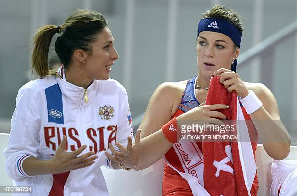 Russia's Anastasia Pavlyuchenkova talks to Russia's team captain Anastasia Myskina playing against German Sabine Lisicki during their Federation Cup...