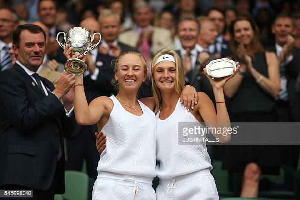 TOPSHOT Russia's Anastasia Potapova poses with the winner's trophy with runner up Ukraine's Dayana Yastremska during the presentation on centre court...