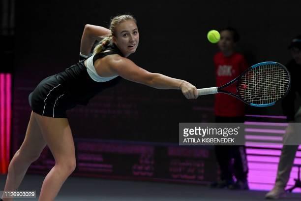 Russia's Anastasia Potapova returns the ball to Czech Republic's Marketa Vondrousova during their semifinal match of the WTA Hungarian Open Ladies'...