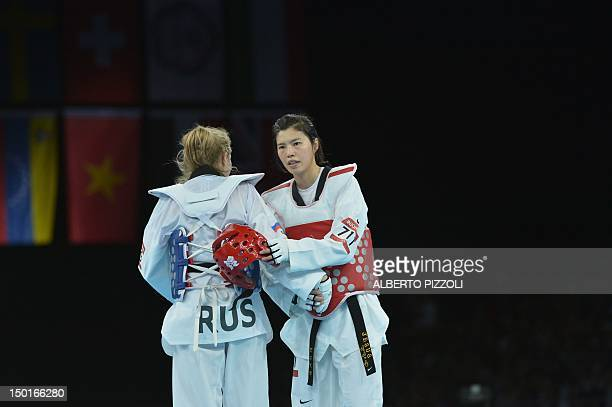 Russia's Anastasiia Baryshnikova celebrates her victory over South Korea's Lee In Jong at the end of their women's taekwondo bronze medal bout in the...