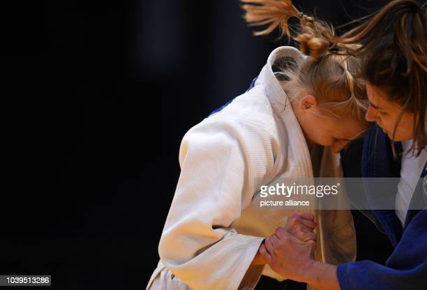 Russia's Anastasiia Konkina and Serbia's Jovana Rogic compete in the 57 kilo category at the Judo Grand Prix in the Mitsubishi Electric Hall in...