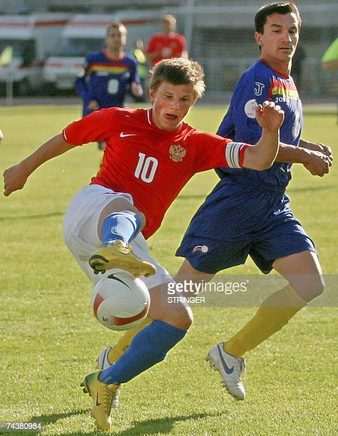 Russia's Andrei Arshavin vies with Andorra's Jordi Escura during their Euro 2008 football qualifying match in StPetersburg 02 June 2007 Russia won 40...