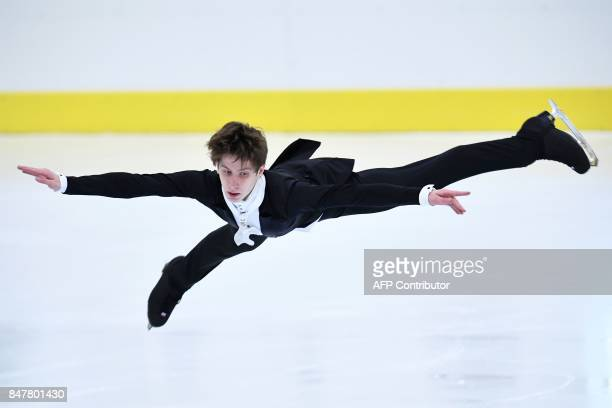 TOPSHOT Russia's Andrei Lazukin performs during the Senior Men's free skating long program during the 10th edition of the Lombardia Trophy 2017 on...