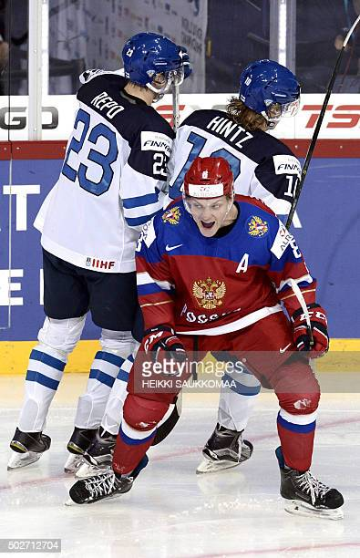 Russia's Andrei Svetlakov celebrates his 23 goal in front of Finland's Sebastian Repo and Roope Hintz during the 2016 IIHF World Junior Ice Hockey...