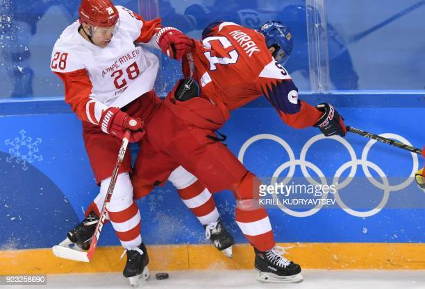 TOPSHOT Russia's Andrei Zubarev clashes with Czech Republic's Roman Horak in the men's semifinal ice hockey match between the Czech Republic and the...