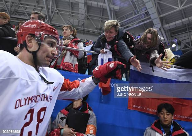 TOPSHOT Russia's Andrei Zubarev greets fans after the men's semifinal ice hockey match between the Czech Republic and the Olympic Athletes from...